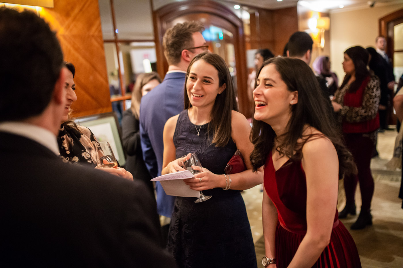two girls smile at a gala dinner